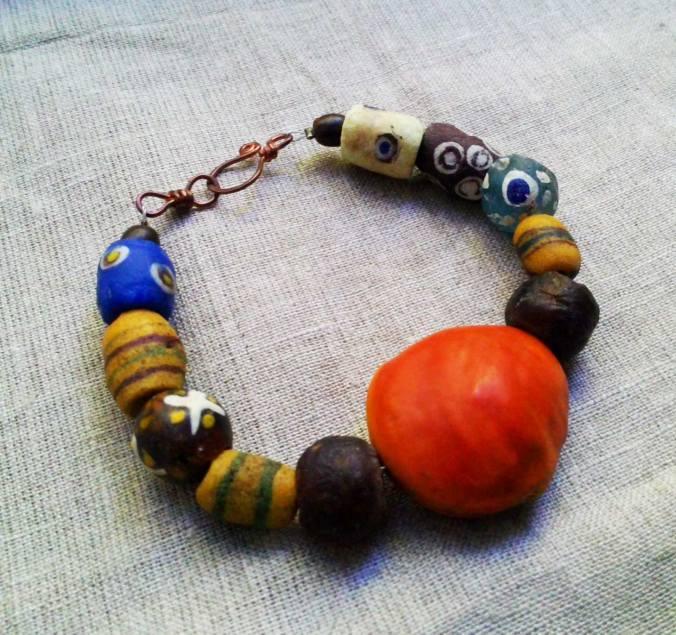 JINUKUN bracelet krobo recycled beads from Ghana and big orange seed
